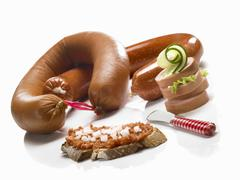 Various types of sausages and bread with Mettwurst (raw minced pork spread) and Stock Photos