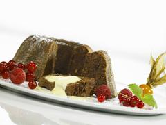Pumpernickel pudding with vanilla sauce Stock Photos