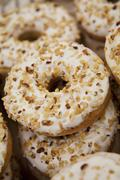 Iced donuts sprinkled with chopped hazel nuts Stock Photos