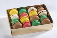 A box of colourful macaroons Stock Photos