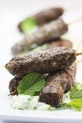 Lamb kofte with tzatziki and mint Stock Photos