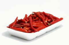 Red chili peppers in a bowl Stock Photos