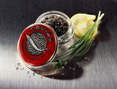 Black caviare from the Caspian Sea in the jar Stock Photos