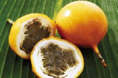 Granadillas (passion fruit), whole and halved Stock Photos