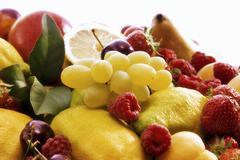 Fruit still life with grapes, berries and lemons Kuvituskuvat