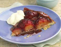 A piece of plum tarte tatin Stock Photos