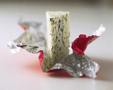 A piece of Roquefort on plastic packaging Stock Photos