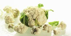 A whole cauliflower with cauliflower florets Stock Photos