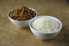 Picture symbolising GI diet: carbohydrates from wholemeal pasta & rice Stock Photos