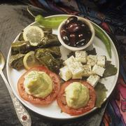 Appetiser plate with stuffed vine leaves, sheep's cheese etc. Stock Photos