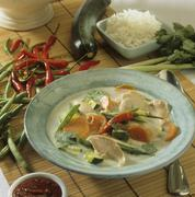 Chicken soup with vegetables and chilli Stock Photos