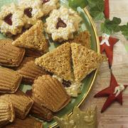 Bear's paws, nut triangles, Linzer stars Stock Photos