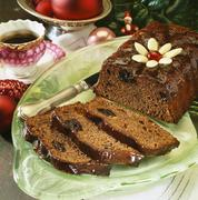 Rum-soaked chocolate and prune cake Stock Photos