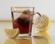 A glass of fruit tea with lemon Kuvituskuvat
