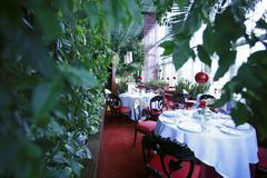 Festive tables in a conservatory Stock Photos