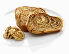 Three slices of walnut cake Stock Photos