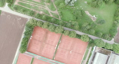 Flying Shot above tennis court and golf links with green encironment. Stock Footage