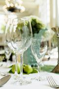 Table laid for special occasion with wine glasses Stock Photos