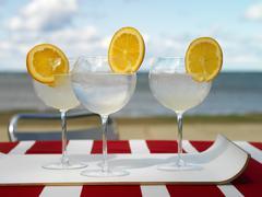 Orange Tonic cocktail on the beach Stock Photos