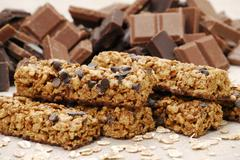 Muesli bars with chocolate chips and pieces of chocolate Stock Photos