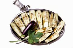 Aubergines being salted to remove liquid Stock Photos