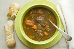 Bowl of Tuscan Beef Stew; Bread Stick Stock Photos