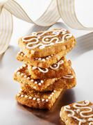 French 'pepper nut' biscuits decorated with icing sugar Stock Photos