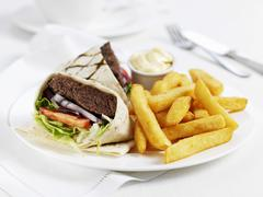 A burger wrap with chips Stock Photos