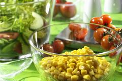 Sweetcorn kernels in a dish Stock Photos
