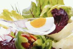 Hard-boiled egg as component of a healthy salad Stock Photos