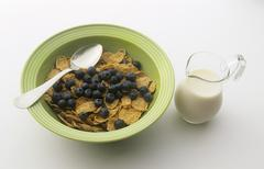 Bran Flake Cereal with Fresh Blueberries; Pitcher of Milk Stock Photos