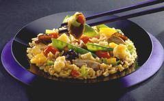 Asian pan-cooked rice dish Stock Photos