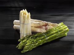 Three types of asparagus in bundles Stock Photos