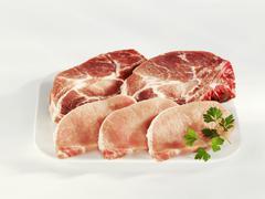 Slices of pork neck and loin Stock Photos
