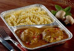 Burgers with gypsy sauce and pasta in aluminium dish Kuvituskuvat