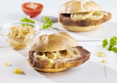 Spit-roasted meat and onions in bread rolls Stock Photos