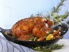 Stuffed poularde with vegetables and herbs Stock Photos