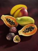 Mango, papaya and passion fruit Stock Photos