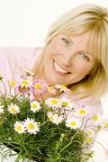 Woman with marguerites Stock Photos