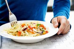Twisting spaghetti with vegetables & mushrooms round fork Stock Photos