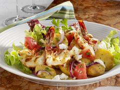 Potato salad with fried prawns Stock Photos