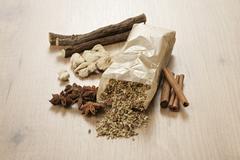 Tea ingredients (liquorice, ginger, anise, cinnamon, fennel, aniseed) Stock Photos