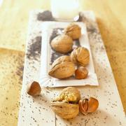 Hazelnuts, walnuts and poppy seeds with a glass of milk Stock Photos
