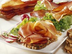 Smoked raw ham and lettuce on whole grain bread Stock Photos