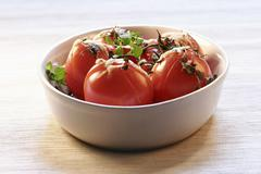 Tomatoes with marjoram and toasted cheese topping Stock Photos