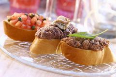 Three canapés with different toppings Stock Photos