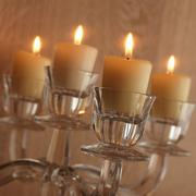 Burning candles in candelabrum Stock Photos