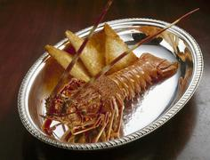Cooked spiny lobster with toast on silver platter Stock Photos