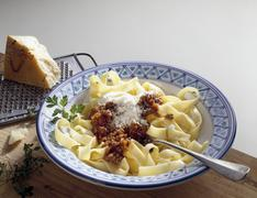 Tagliatelle with Bolognese sauce and grated Parmesan Stock Photos