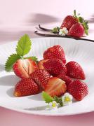 Fresh strawberries and vanilla pod Stock Photos